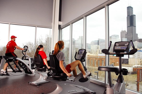 students on exercise machines with a view of the Sears Tower
