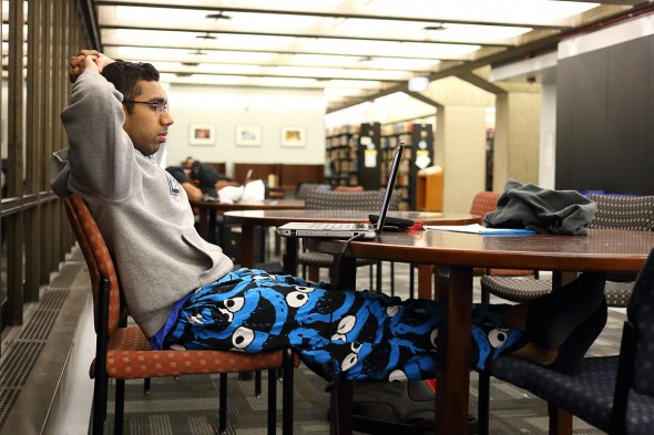 Selwyn Varghese studies in his pajamas at 3:34 a.m.