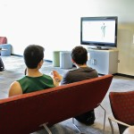 Students watching soccer in a lounge area
