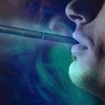 man with e-cigarette in mouth