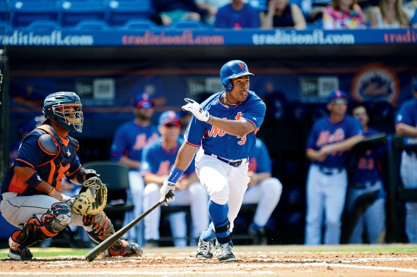 Curtis Granderson watches his hit as he leaves home plate