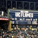 "U.S. Cellular Field scoreboard reading ""UIC FLAMES"""