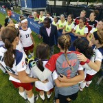 Women's soccer team huddle up before a game