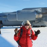 Hilary Dugan next to an Air Force plane in Antarctica