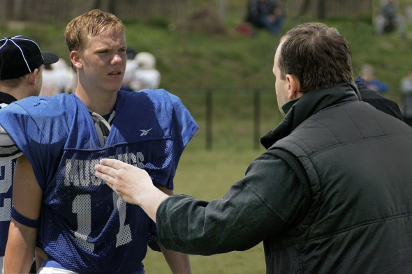 football coach talking to player