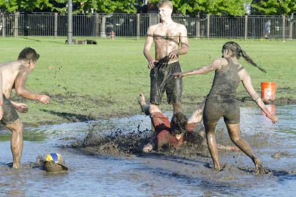 student falling in the muddy water
