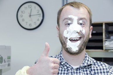 Jeffrey Dolder gives a thumbs up with a pie face