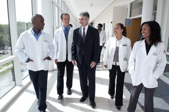medical students walk with administrator