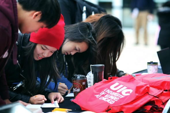 Visitors register for Open House at the UIC Forum on September 13th