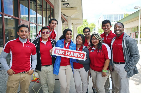 The Orientation Team holding a UIC Flames sign