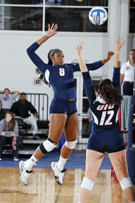Stephenee Yancy leaping to make a spike
