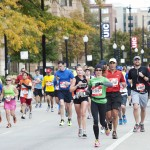 Chicago Marathon runners pass the UIC campus