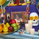 Day of the Dead altar at the Latino Cultural Center with a photo of Rafael Cintrón