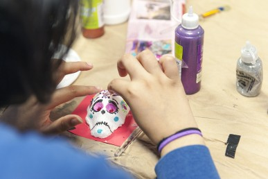 Veronica Jaramillo decorates a sugar skull