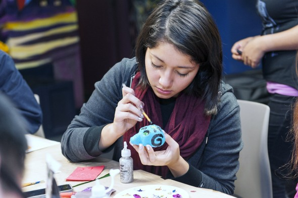 Danielle Nehmer decorating a sugar skull for Day of the Dead