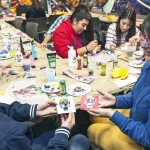 Mariano Rivera and Veronica Jaramillo decorating sugar skulls for Day of the Dead;
