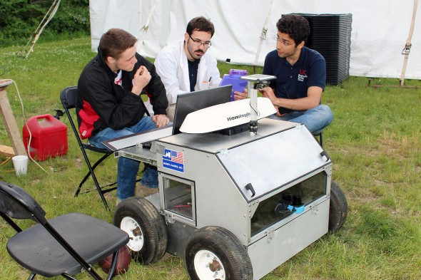 Members of UIC's Chicago Engineering Design Team discuss their robot