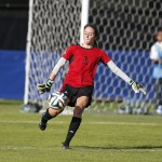 Kelly Fritz kicks the ball away from her own goal