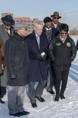 Mayor Rahm Emanuel (center) views the site with Ald. Jason Ervin, 28th Ward; Ald. Walter Burnett, 27th Ward; Marcus Betts of the North Lawndale Presidential Library Committee, ____ and Ald. Emma Mitts, 37th Ward.