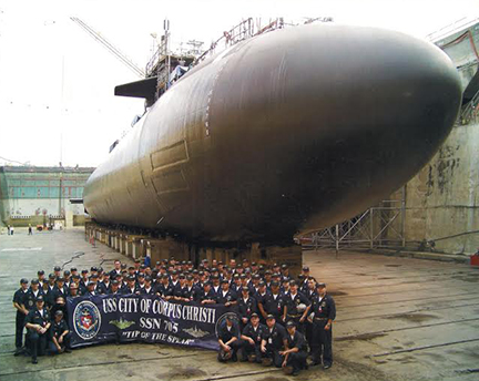 Shane Murphy and Navy members in front of a submarine