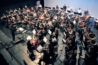Aerial view of symphonic band and conductor performing