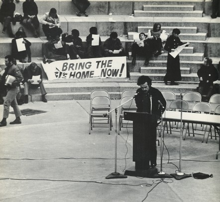 Man speaks at a lectern during Moratorium Day