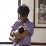 nurse holding baby in nursery room