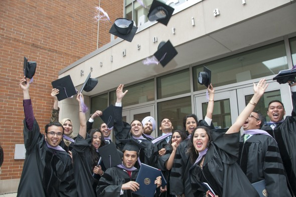 students toss their hats in the air