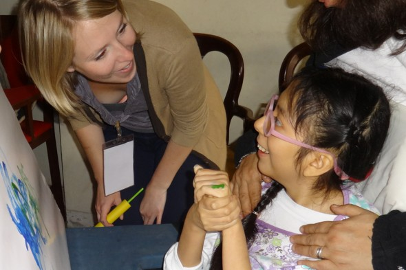 UIC occupational therapy student Carson Mumma works with a student at Centro Ann Sullivan del Peru in Lima, a UIC exchange program in the College of Applied Health Sciences.