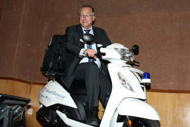 Dr. Terry Vanden Hoek on one of the HeartRescue India mopeds