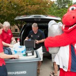 Freshman Daniel Stewart gets a hand from the Amiridis', Susan Teggets, Director of Campus Housing and Sparky.