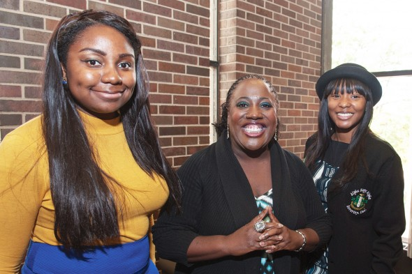 Sheryl Underwood with students Daera Jones, left, and Mikita Lee, right