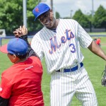 Curtis Granderson high-fives a boy
