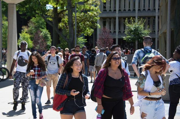 crowd of students walking on east campus