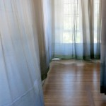 96 Acres divides Hull-House with a curtain in their exhibition.