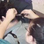 woman cuts the hair of another woman
