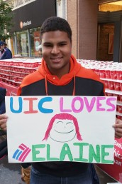 Edgar George holds a poster supporting Elaine Trinn, an RA at Commons West who ran the Marathon.