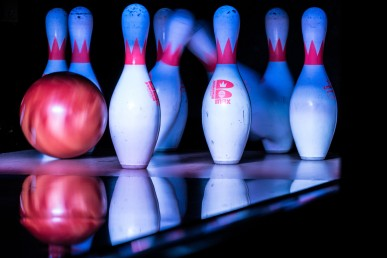 Bowling_Pins_Being_Hit_by_a_Bowling_Ball_-_PINSTACK_Plano_(2015-04-10_19.34.19_by_Nan_Palmero)