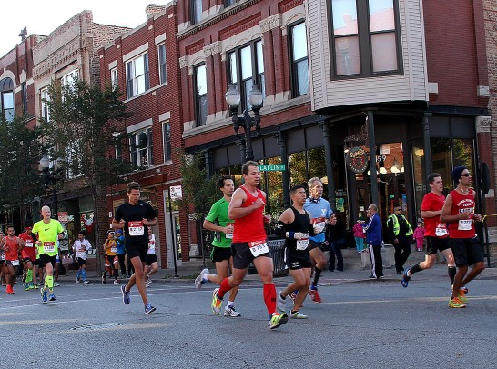 Chicago Marathon participants running down Taylor Street