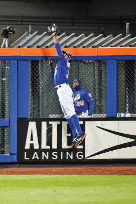 Curtis Granderson leaping to save a home run