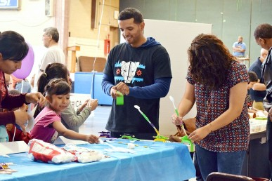 UIC engineering students Cristian Xavier Vargas and Catherine Santis guide young experimenters at a STEM fair. Photo by STARS Project Engineering Academy