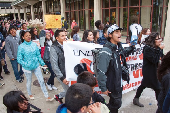 Students and community members march on campus in support of proposed legislation that would provide access to financial aid to undocumented students