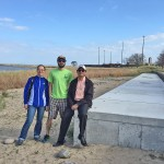 Engineering professor Krishna Reddy (right) visits the filtration system he designed with research assistants Yuling Yang and Drake Pitynski at Rainbow Beach. - See more at: http://news.uic.edu/engineers-help-keep-beaches-clean#sthash.If8c9StF.dpuf