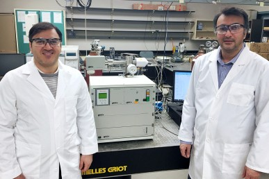 Mohammad Asadi and Amin Salehi-Khojin with their specially modified differential electrochemical mass spectrometry (DEMS) instrument.