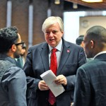UIC Chancellor Michael Amiridis talking with two attendees