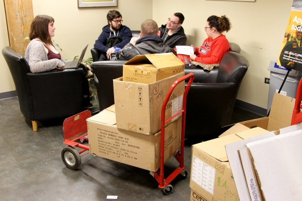 Students study together in the College of Urban Planning and Public Affairs Thursday as employees move back into their offices. — Photos: R. Glass