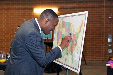 man places a pin on a map at the school into which he placed on match day