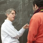Mark Schlossman working with a student