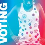 "woman wearing tank top covered in ""vote"" buttons"