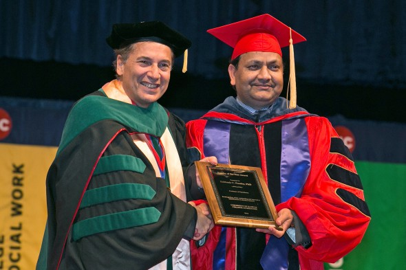 College of Medicine dean Dimitri Azar presents Subhash Pandey with the Faculty of the Year Award